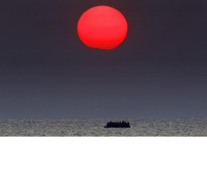 Syrian refugees on a dinghy drift in the Aegean sea off the Greek island of Kos in Greece
